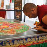 monk preparing mandala