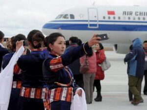Girls welcoming Tibet Flight